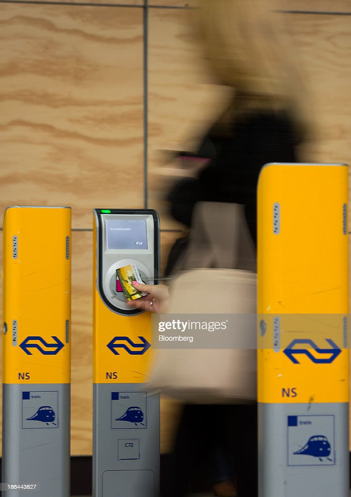 A commuter swipes their travel pass on self-service OV-chipkaart ticket reader, operated by Nederlandse Spoorwegen at the Utrecht Centraal station in Utrecht, Netherlands, on Thursday, Oct. 31, 2013. The European Union wants to prevent a requirement that at least 10 percent of energy for road and rail transport in 2020 come from renewable sources. Photographer: Jasper Juinen/Bloomberg via Getty Images