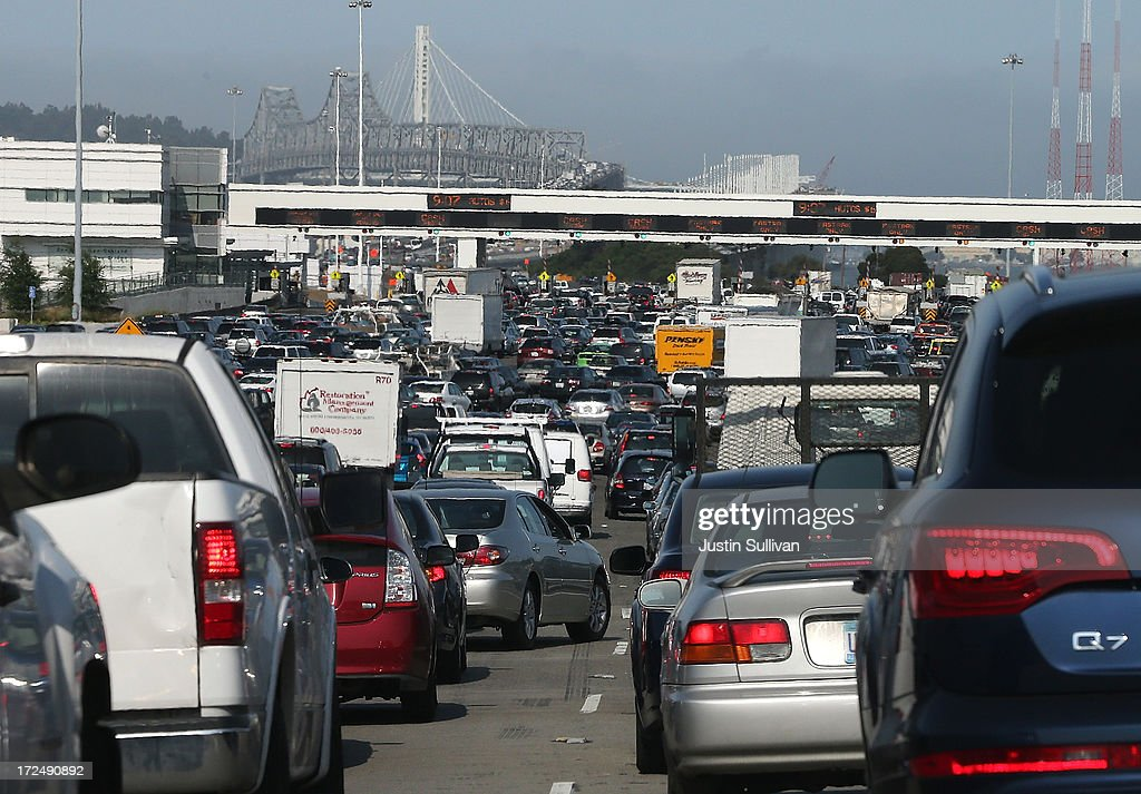 Commuter traffic backs up at the toll plaza to the San Francisco-Oakland Bay Bridge on July 2, 2013 in Oakland, California. For a second day, hundreds of thousands of San Francisco Bay Area commuters are scrambling to find ways to work after two of San Francisco Bay Area Rapid Transit's (BART) largest unions went on strike early yesterday morning following contract negotiations with management falling apart the day before. Train operators, mechanics, station agents and maintenance workers are seeking a five percent wage increase and are fighting management who want to have workers to begin contributing to their pensions, pay more for health insurance and reduce overtime expenses.