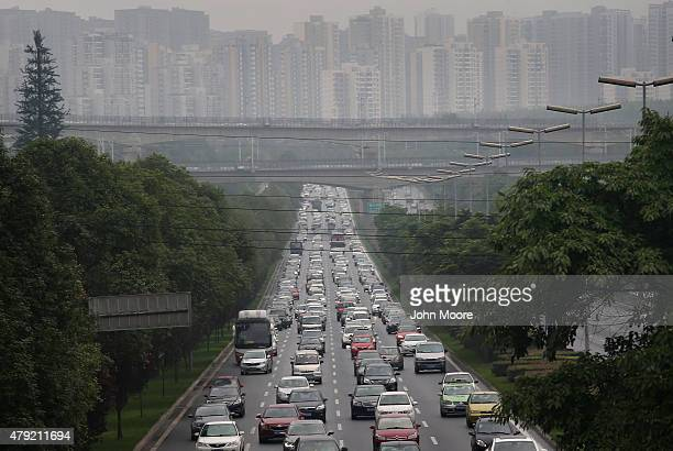 Commuter traffic flows from a skyline of apartment buildings on June 30 2015 in Chengdu China First inhabited more than 4 thousand years ago Chengdu...