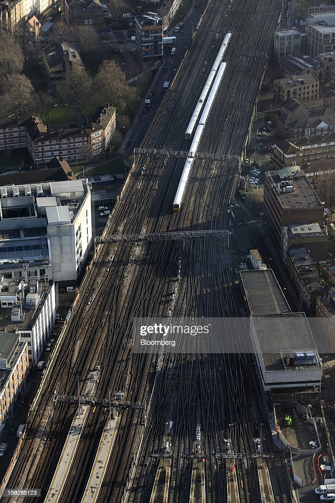 Commuter trains are seen arriving and departing from London Bridge mainline rail station from 'The View From The Shard', a series of viewing galleries near the top of the Shard tower in London, U.K., on Wednesday, Jan. 9, 2013. The Shard, which stands at 309.6 meters on London's South Bank, is owned by LBQ Ltd., which brings together the State of Qatar (the majority shareholder) and Sellar Property Group Ltd., with non-equity funding by Qatar National Bank. Photographer: Chris Ratcliffe/Bloomberg via Getty Images