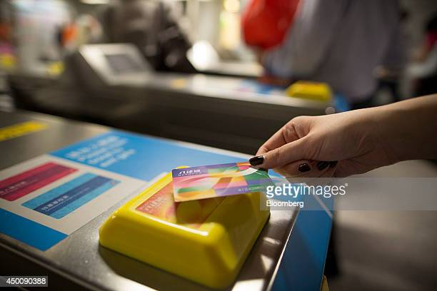 A commuter uses an octopus card at the turnstiles inside MTR Corp's Central station in Hong Kong China on Tuesday May 27 2014 Hong Kongs government...