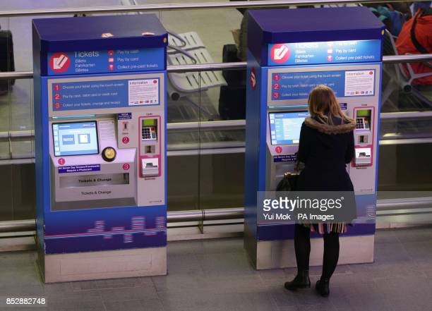 A commuter using a ticket machine at Kings Cross Station in London on the day that new train fares come into force