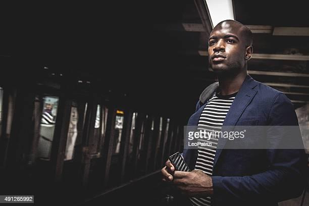 Commuter waiting on subway platform