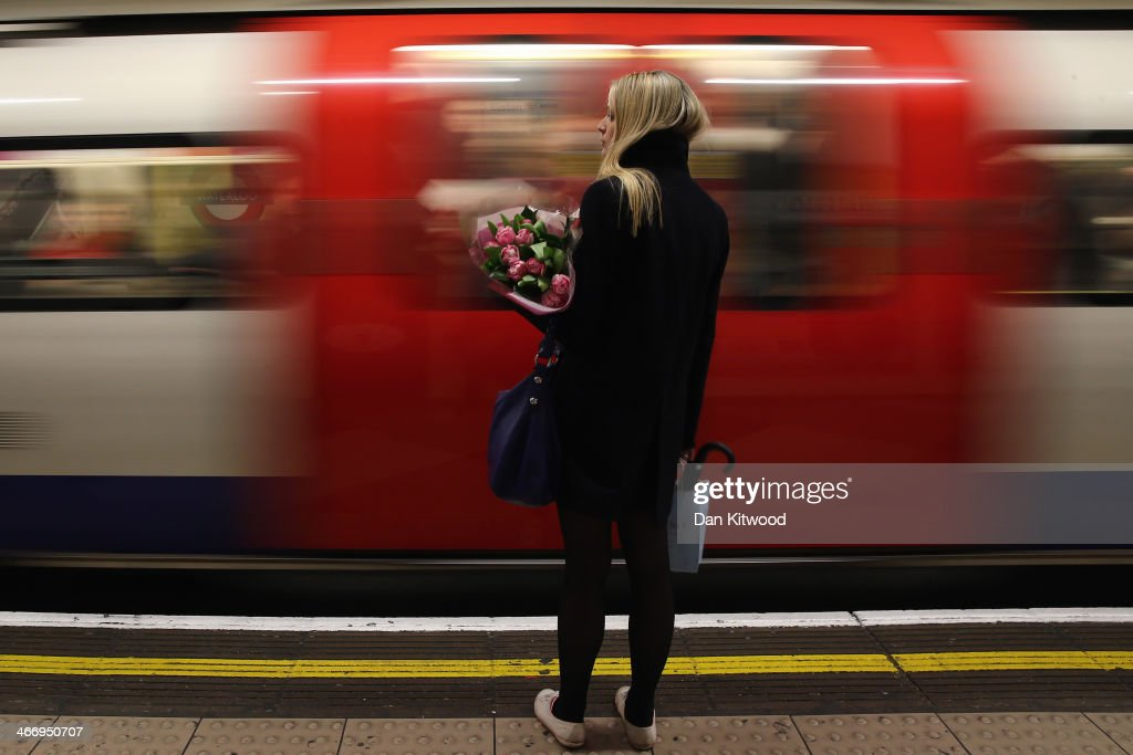 A commuter waits for the next tube at Waterloo Station on February 5 in London England Today marks the first full day of a 48 hour strike by London...
