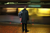 Commuter waits to board a Metrorail train at Union Station March 15 2016 in Washington DC Metrorail announced today that they will shut down service...