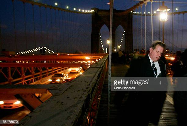 A commuter walks across the Brooklyn Bridge during the evening rush hour December 21 2005 in New York Transport Workers Union President Roger...