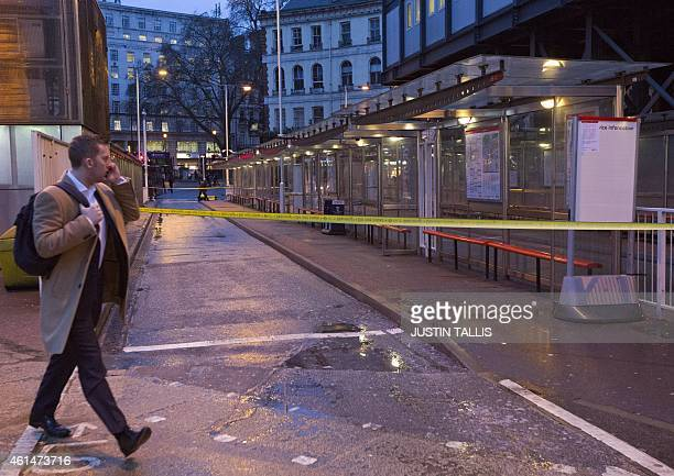 A commuter walks past closed bus bays at Victoria Bus Station during a one day strike by bus drivers in London on Janurary 13 2015 Bus drivers from...