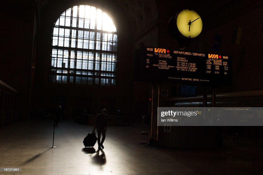 A commuter walks through Union Station, the heart of VIA Rail travel, on April 22, 2013 in Toronto, Ontario, Canada. The Royal Canadian Mounted Police (RCMP) report they have arrested two people connected to an alleged Al Qaeda plot to detonate a bomb on a VIA Rail train in Canada.