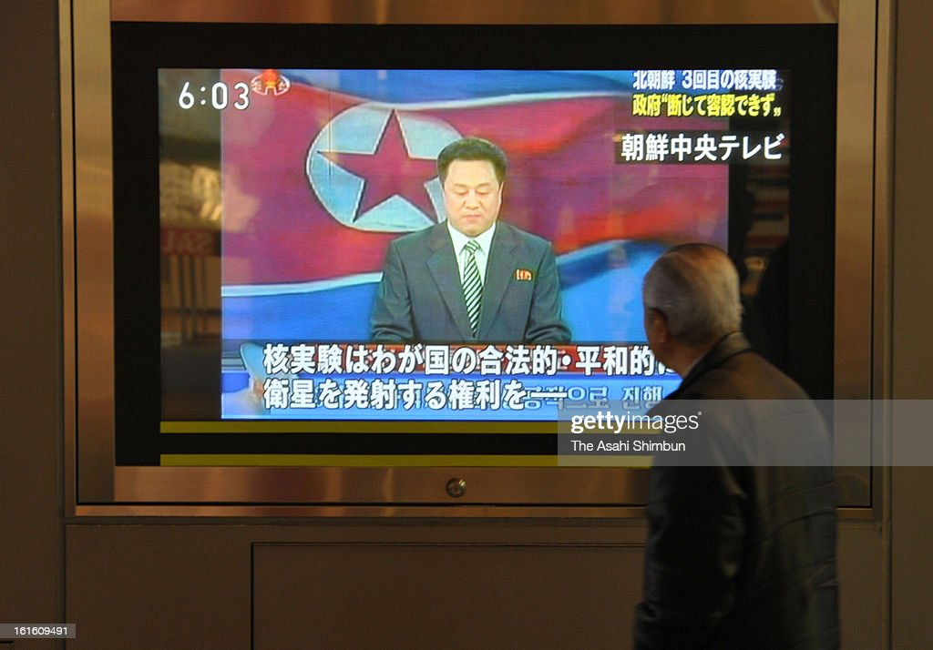 A commuter watches a televsion broadcasting reporting the North Korea's nuclear test at an electronics store on February 12, 2013 in Tokyo, Japan. North Korea confirmed it had successfully carried out an underground nuclear test as a shallow earthquake with a magnitude of 4.9 was detected by several international monitoring agencies. South Korea and Japan both assembled an emergency meeting of their respective national security teams after the incident.