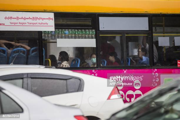 A commuter wears a face mask whilst taking a bus in Yangon on July 26 2017 Two people including a pregnant woman have died from swine flu in Yangon...