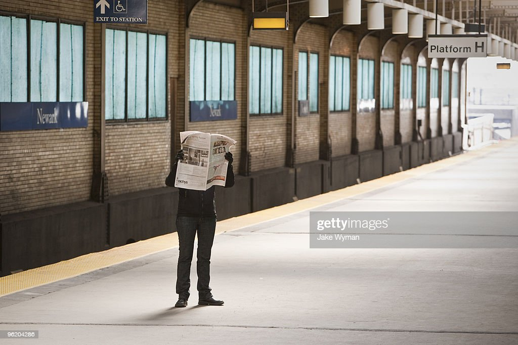 Commuter with newspaper : Stock Photo