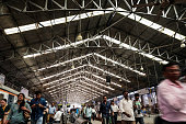 Commuters and passengers walk along a platform at Churchgate railway station in Mumbai India on Saturday Feb 21 2015 Indian Railways is scheduled to...
