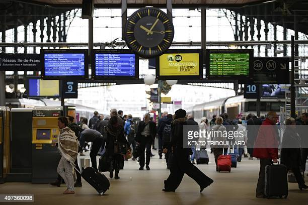Commuters and travellers walks through the Gare du Nord railway station on November 16 2015 in Paris three days after the terrorist attacks that left...