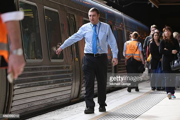 Commuters are escorted by Metro Train staff at Flinders Street Station shortly before Train Union workers start their strike on September 4 2015 in...