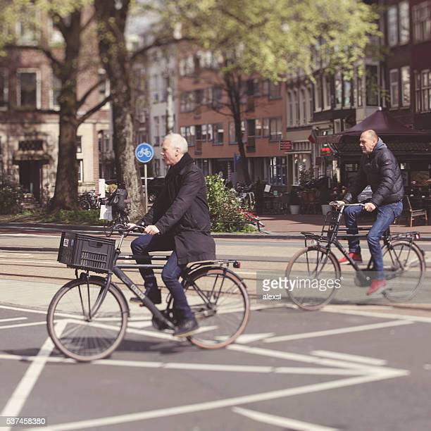 Commuters are riding a bicycle on in Amsterdam