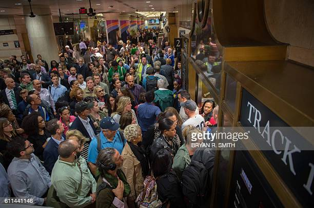 Commuters are seen at the New Jersey Transit platform in Penn Station in New York after a train accident this morning at the Hoboken Train Terminal...