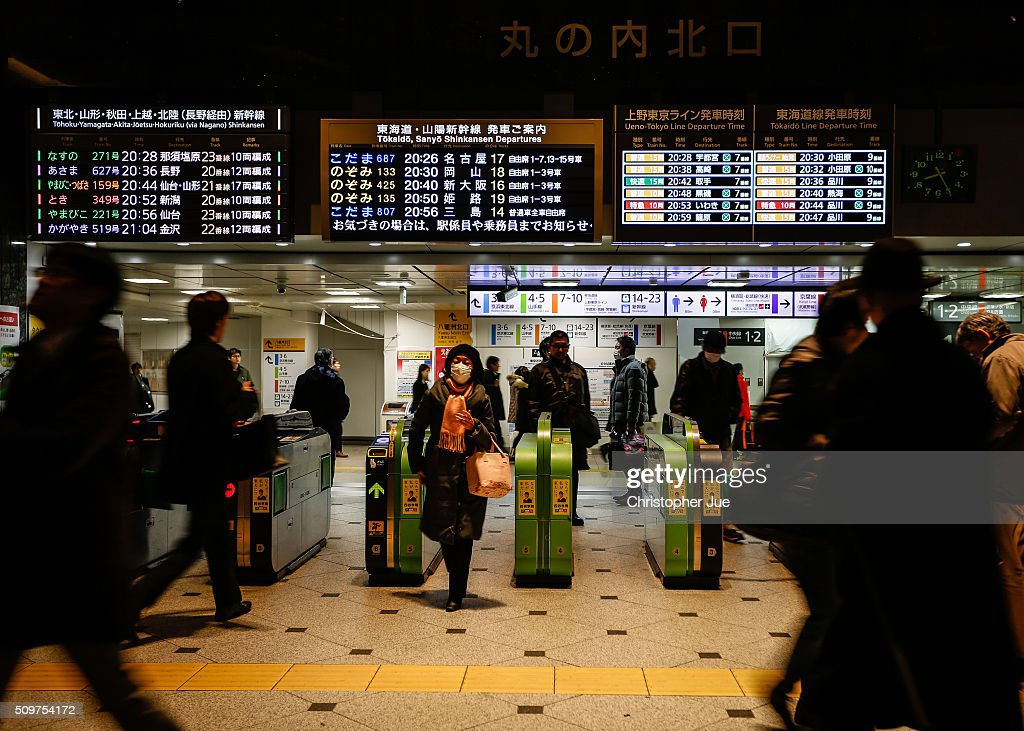 Commuters are seen inside Tokyo station on February 12, 2016 in Tokyo, Japan. The Nikkei Stock Average finished 11% down for the week, its biggest weekly drop since October 2008, and the index for the day ended 4.8% down, the lowest since October 2014.