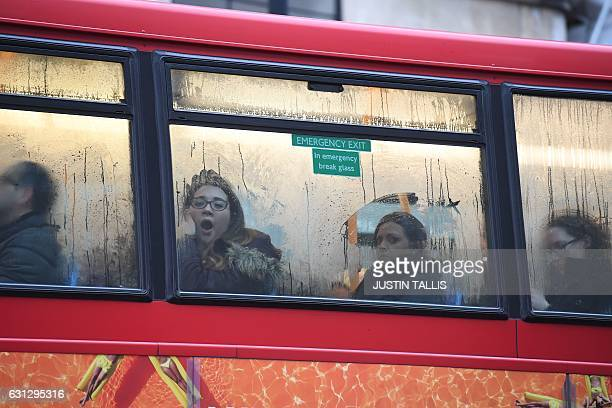 Commuters are seen through the window of a bus at Victoria bus station in central London on January 9 2017 A strike on the London Underground caused...