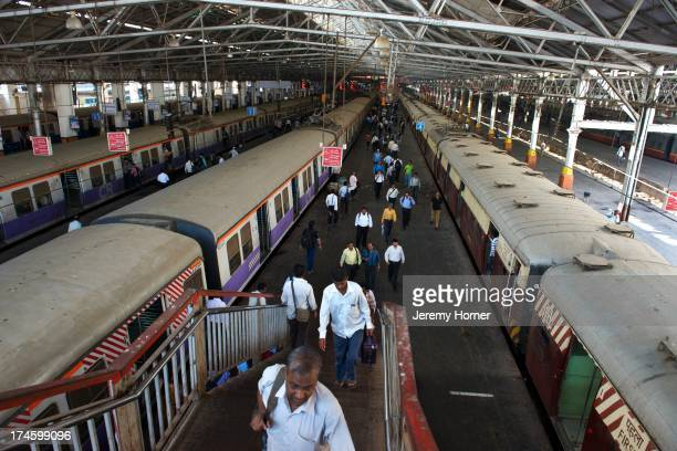 Commuters arrive at Victoria Terminus during morning rush hour