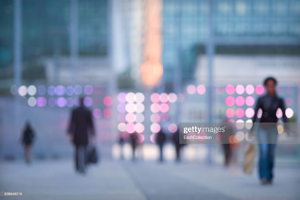 Commuters arriving at modern business district