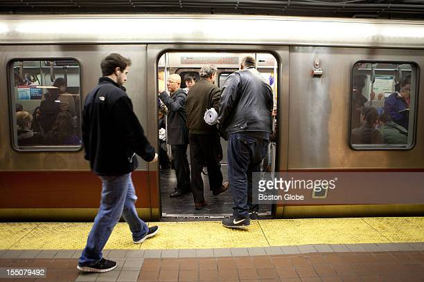 Commuters at South Station board the Red Line T train before 200 on Monday October 29 2012 The MBTA commuter train in Boston Massachusetts was closed...