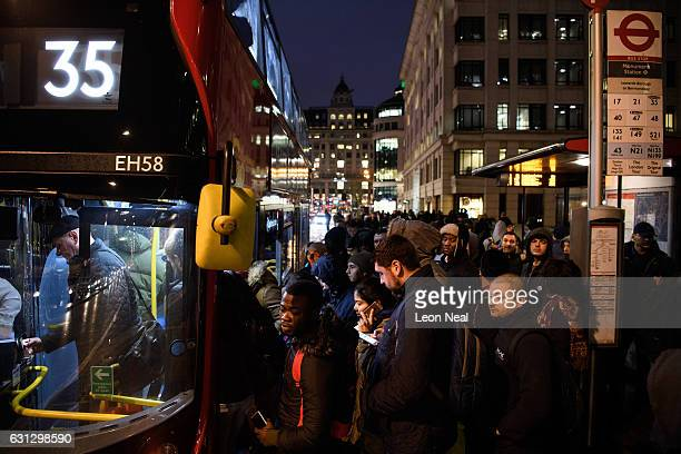 Commuters attempt to board a crowded bus on London Bridge as a planned tube strike on the London underground network takes place on January 9 2017 in...