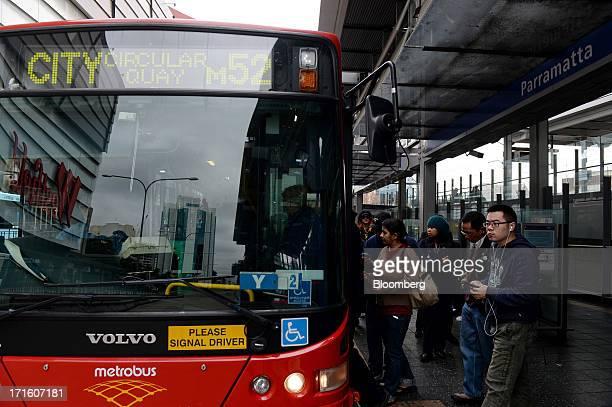 Commuters board a bus outside Parramatta train station in western Sydney Australia on Monday June 24 2013 Chris Bowen a key backer of returned Prime...