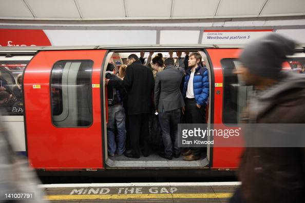 Commuters board a carriage at Bank London Underground station on March 5 2012 in London England London's underground rail system commonly called the...