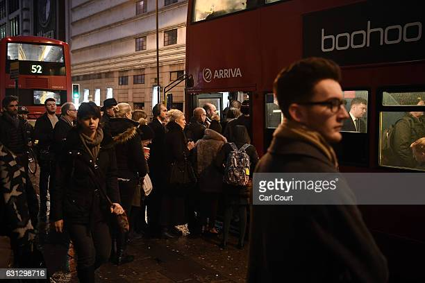 Commuters board a crowded bus at Victoria Station on January 9 2017 in London England Millions of people are facing severe travel disruption after...