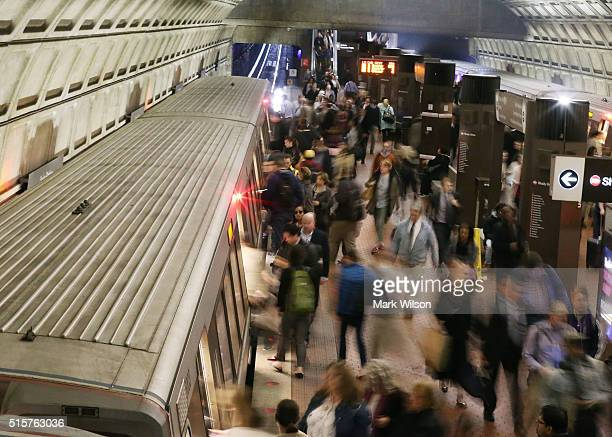Commuters board a Metrorail train at Union Station March 15 2016 in Washington DC Metrorail announced today that they will shut down service entirely...