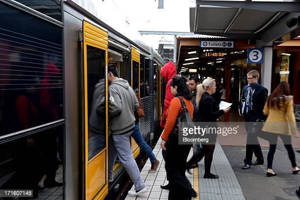 Commuters board a train at Parramatta station in western Sydney Australia on Monday June 24 2013 Chris Bowen a key backer of returned Prime Minister...
