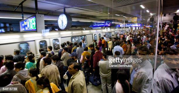 Commuters board trains on a section of the newly completed Metro on February 16 2009 in Delhi India Parts of the capital's metro system have gone...