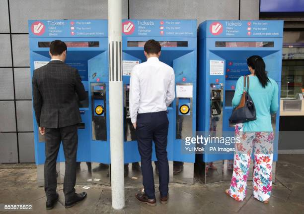 Commuters buy train tickets from machines at Finsbury Park station in north London as rail passengers will today learn just how much their season...