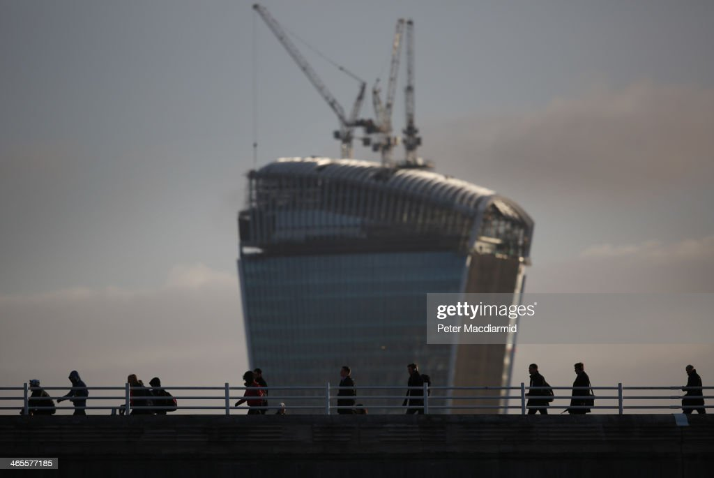 Commuters cross Waterloo Bridge in sight of the Walkie Talkie building on January 28, 2014 in London, England. A new report suggests that one out of three 22 to 30 year olds leave their home town to seek work in the capital which creates ten times as many private sector jobs as any other city.
