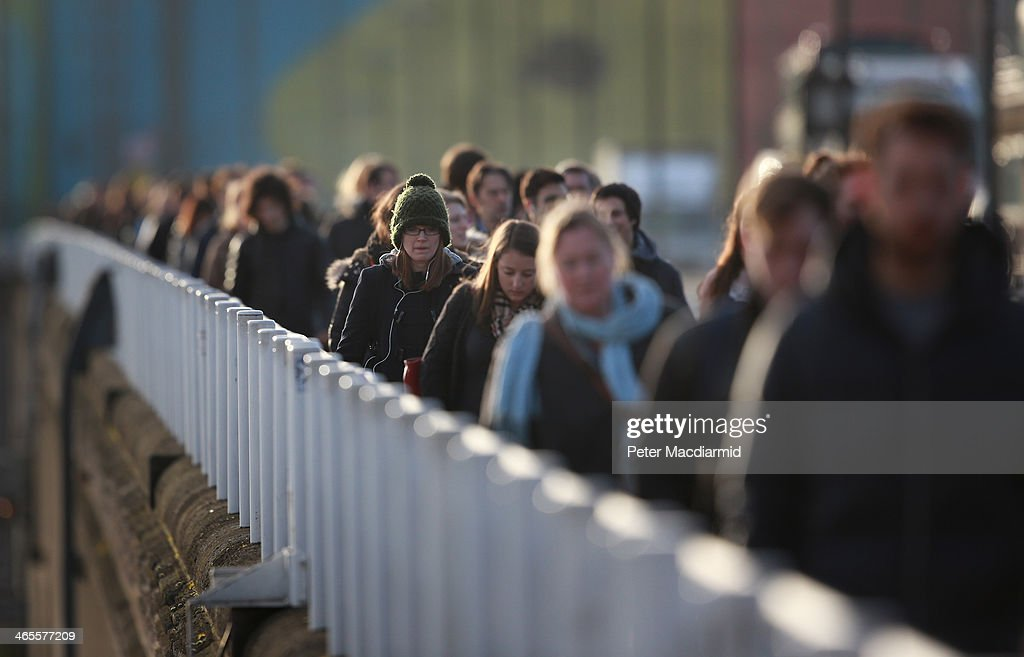 Commuters cross Waterloo Bridge on January 28, 2014 in London, England. A new report suggests that one out of three 22 to 30 year olds leave their home town to seek work in the capital which creates ten times as many private sector jobs as any other city.