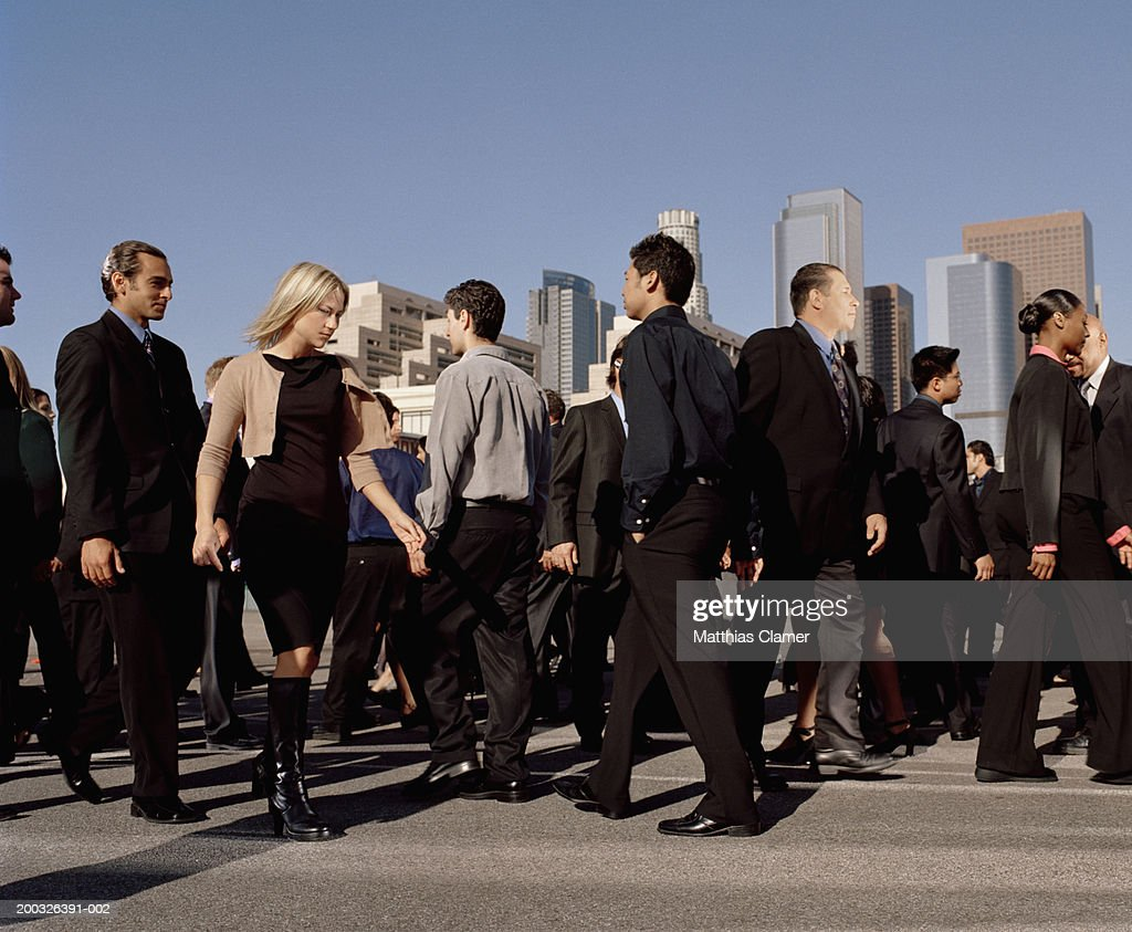 Commuters crossing street, side view : Stock Photo