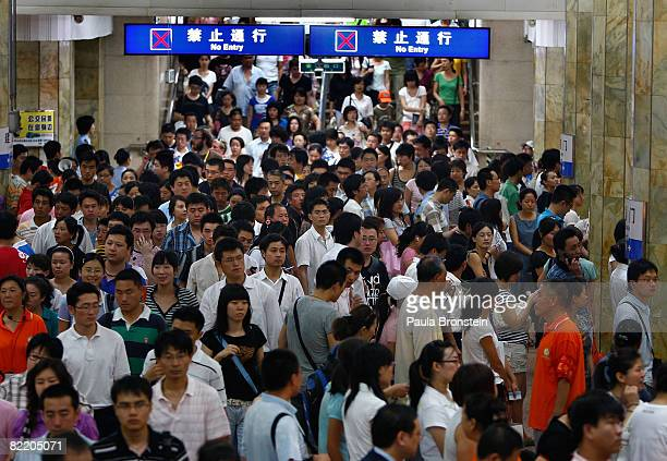 Commuters crowd a subway station at rush hour on August 7 2008 in Beijing China Ten thousand athletes have arrived in China for the Olympics along...