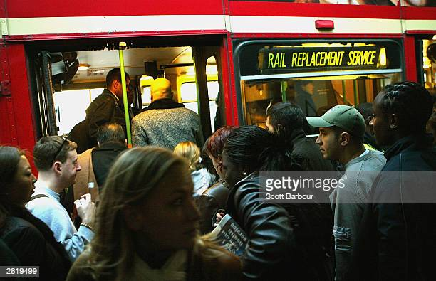 Commuters crowd onto a bus outside of Euston underground station October 20 2003 in London Underground travellers have had to make alternative travel...