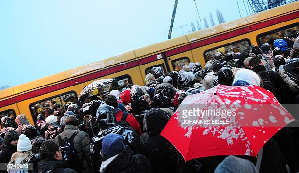 Commuters crowding a platform try to enter an SBahn train at the Ostkreuz station on early morning on December 2 2010 in Berlin as the capital is...