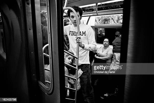 CONTENT] commuters curiously looking out of the closing doors of a subway car while a kid is standing on the bench subway NYC