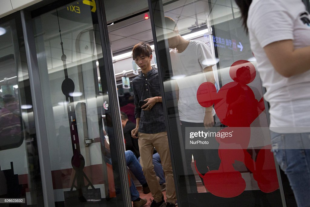 Commuters drop off on Disneyland Station in Pudong District in Shanghai, China. Disneyland Shanghai still under costruction and has planned to open on June 16, 2016.