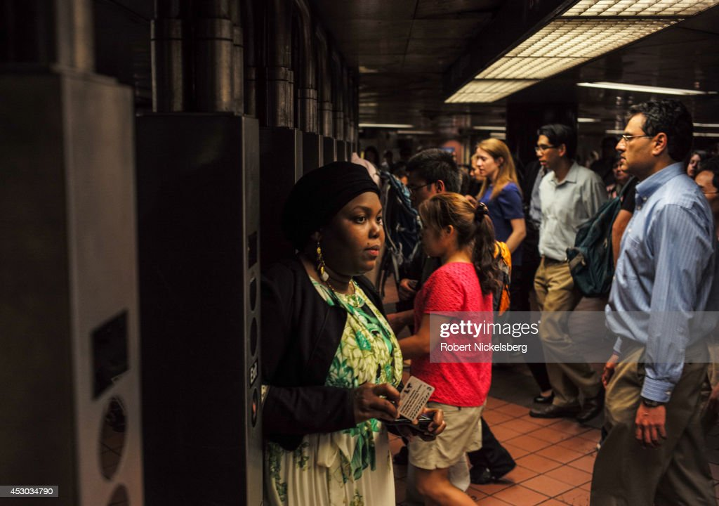 Commuters enter and exit a Metropolitan Transportation Authority subway station July 21, 2014 in the Manhattan borough of New York.