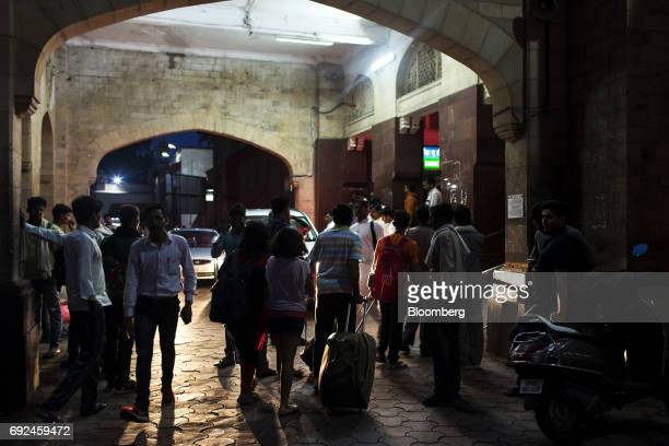 Commuters enter and exit Gwalior Railway Station in Gwalior Madhya Pradesh India on Wednesday May 31 2017 India'srates traders seem convinced...