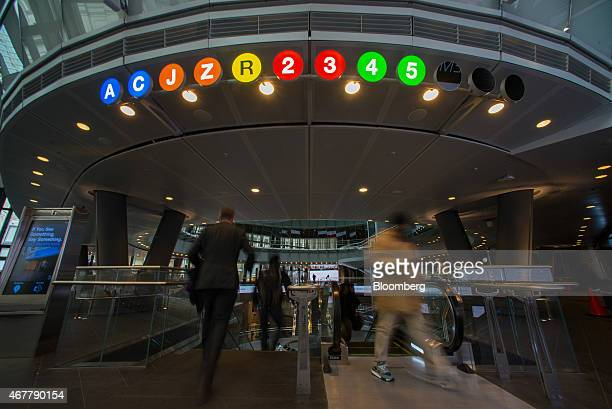 Commuters enter and exit the Fulton Street subway station in New York US on Thursday March 26 2015 It now costs $275 to ride the New York subway as...