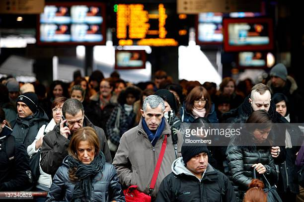Commuters enter Cadorna train station in Milan Italy on Thursday Jan 19 2012 Italian Prime Minister Mario Monti's Cabinet will meet in Rome tomorrow...