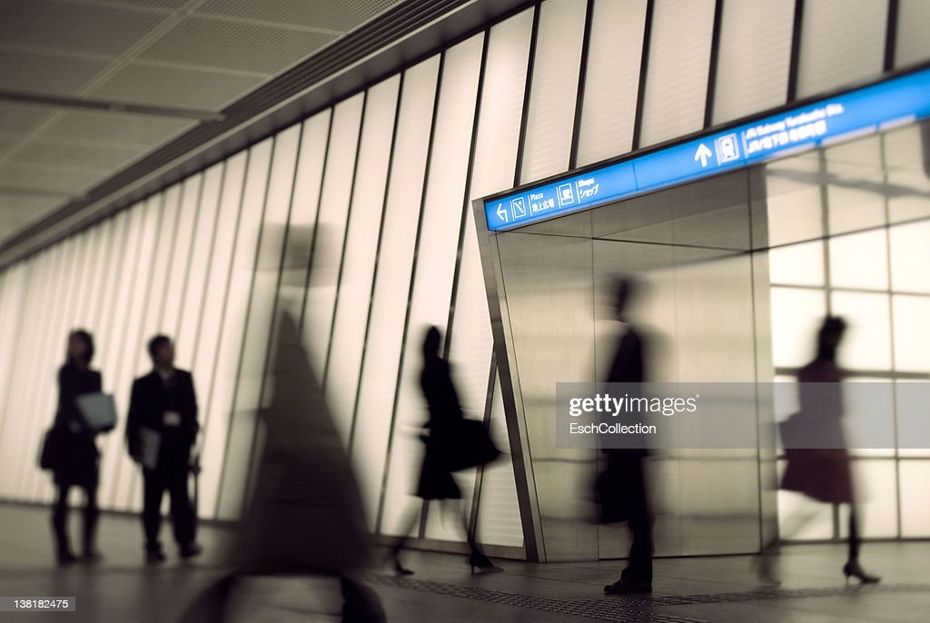 Commuters entering metro station in Tokyo, Japan : Stock Photo