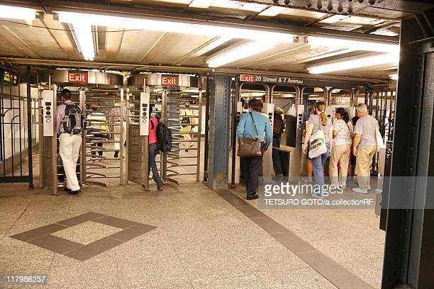 Commuters Entering Subway Station