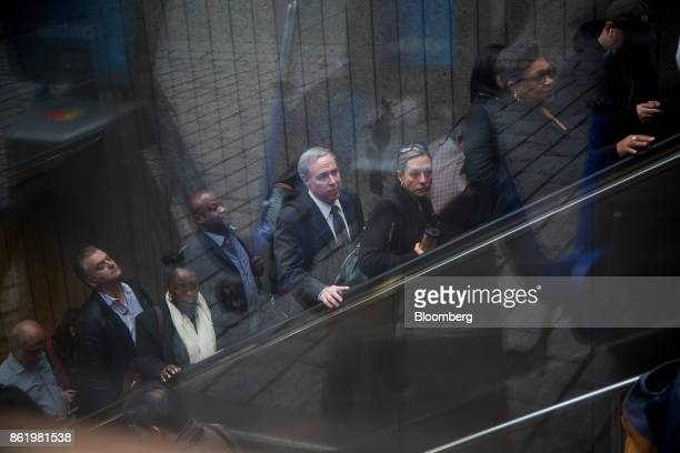 Commuters exit a subway station near the New York Stock Exchange in New York US on Monday Oct 16 2017 The dollar strengthened and Treasuries fell...