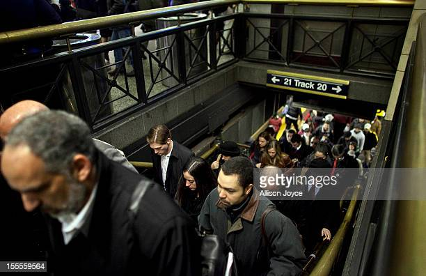 Commuters exit the Long Island Railroad platform at Penn Station November 4 2012 in New York City A week after Superstorm Sandy hit the city most of...