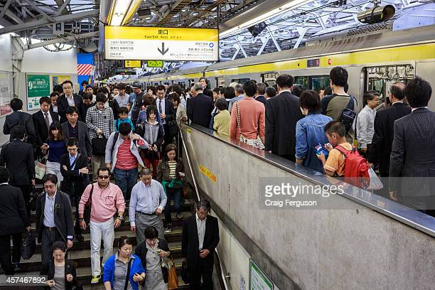 Commuters exit the platform at Shinjuku station said to be the busiest railway station in the world